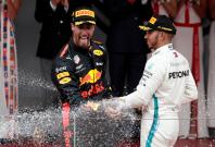 Formula One F1 - Monaco Grand Prix - Circuit de Monaco, Monte Carlo, Monaco - May 27, 2018 Red Bull's Daniel Ricciardo celebrates winning the race with Mercedes' Lewis Hamilton who finished third