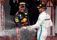 Formula One F1 - Monaco Grand Prix - Circuit de Monaco, Monte Carlo, Monaco - May 27, 2018 Red Bull's Daniel Ricciardo celebrates winning the race with Mercedes' Lewis Hamilton who finished third