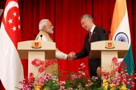 India's Prime Minister Narendra Modi shakes hands with Singapore's Prime Minister Lee Hsien Loong