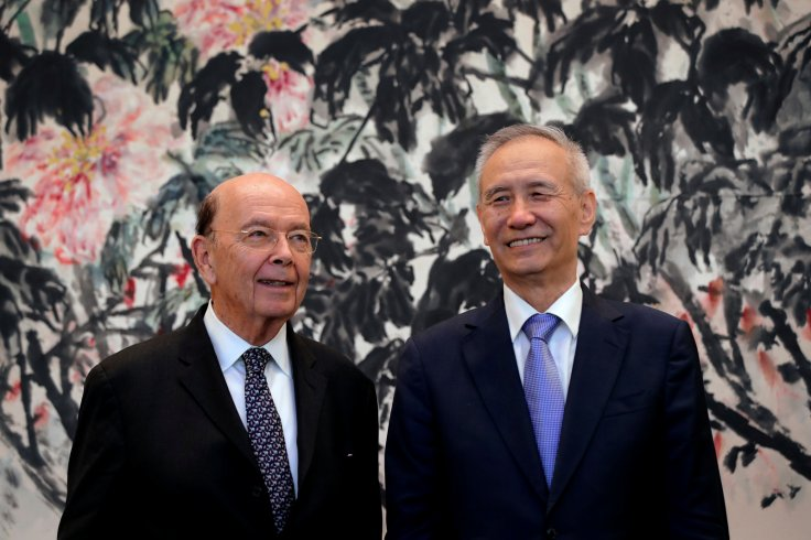 U.S. Commerce Secretary Wilbur Ross, left, chats with Chinese Vice Premier Liu He during a photograph session after their meeting at the Diaoyutai State Guesthouse in Beijing, China Sunday, Jun 3, 2018.