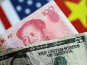 Illustration photo of U.S. Dollar and China Yuan notes