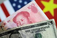 Illustration photo of U.S. Dollar and China Yuan notes