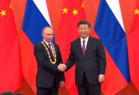 russian-president-vladimir-putin-receives-friendship-medal-from-chinese-president-xi-jinping
