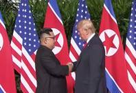 trump-and-kim-jong-un-shake-hands-in-historic-summit-meeting