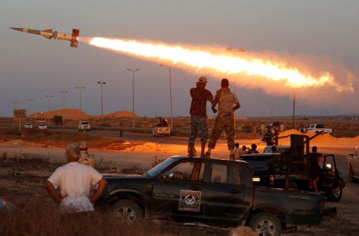 Fighters of Libyan forces allied with the UN backed government fire a rocket at Islamic State fighters in Sirte, Libya