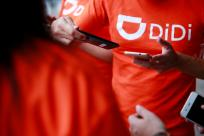 The logo of Chinese ride-hailing firm Didi Chuxing is seen on a t-shirt of an employee outside their new drivers center in Toluca, Mexico,
