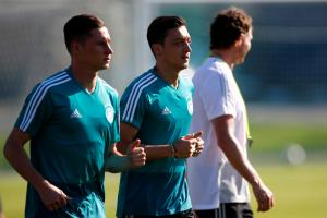 Soccer Football - World Cup - Germany Training - Germany Training Camp, Moscow, Russia - June 16, 2018 Germany's Julian Draxler and Mesut Ozil during training