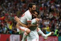 Spain's Diego Costa celebrates scoring their first goal with Isco