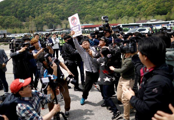 A North Korean defector tries to take an activist who opposes releasing balloons containing leaflets denouncing North Korean leader Kim Jong Un, away near the demilitarized zone in Paju, South Korea, May 5, 2018.