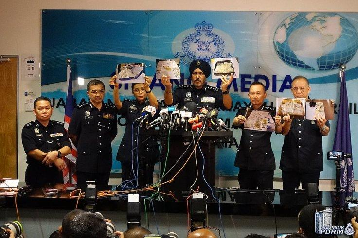 Malaysian police seized cash and illegal items