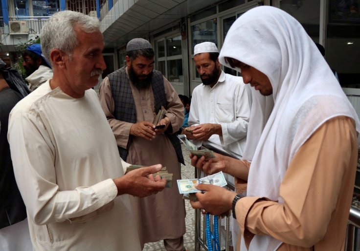 Afghan money changers gather to deal with foreign currency at a money change market in Herat province, Afghanistan June 3, 2018.