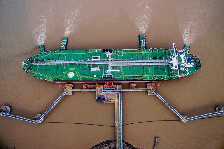 An oil tanker unloads crude oil at a crude oil terminal in Zhoushan, Zhejiang province, China July 4, 2018. Picture taken July 4, 2018.