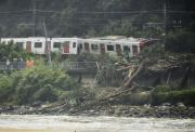 Derailed train caused by a landslide following heavy rain is seen in Karastu, southwestern Japan, in this photo taken by Kyodo July 7, 2018.