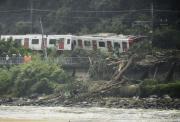Derailed train caused by a landslide following heavy rain is seen in Karastu, southwestern Japan, in this photo taken by Kyodo July 7, 2018.