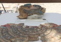 A broken mummy mask is seen inside a glass casing, on display near Egypt's Saqqara necropolis, in Giza Egypt July 14, 2018.