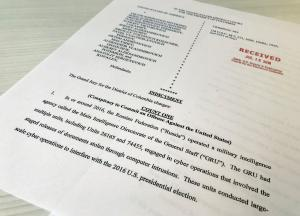 A copy of the grand jury indictment against 12 Russian intelligence officers is seen after the indictments were filed in U.S. District Court by prosecutors working as part of special counsel Robert Mueller's Russia investigationÊin Washington, U.S.