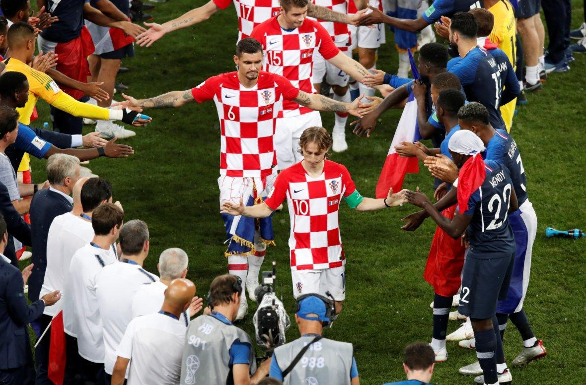 Croatia players shake hands with France players