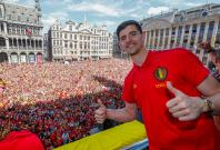 Golden Glove winner Thibaut Courtois waves to the fans while appearing on the balcony of the city hall at the Brussels' Grand Place, after taking the third place in the World Cup 2018, in Brussels, Belgium