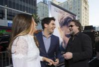 "Director of the movie and cast member Russell Crowe (R) greets actor Eli Roth and his wife Lorenza Izzo at the premiere of ""The Water Diviner"" at the TCL Chinese theatre in Hollywood, California April 16, 2015. The movie opens limitedly in the U.S. on Apr"