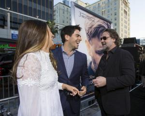 """Director of the movie and cast member Russell Crowe (R) greets actor Eli Roth and his wife Lorenza Izzo at the premiere of """"The Water Diviner"""" at the TCL Chinese theatre in Hollywood, California April 16, 2015. The movie opens limitedly in the U.S. on Apr"""