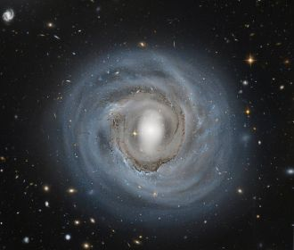 How far away is spiral galaxy NGC 4921? Although presently estimated to be about 310 million light years distant, a more precise determination could be coupled with its known recession speed to help humanity better calibrate the expansion rate of the enti