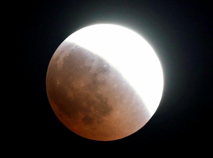 The moon is seen during a lunar eclipse over Cairo, Egypt July 27, 2018.