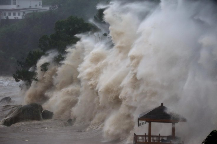 Waves brought by Typhoon Maria lash the shore in Wenzhou, Zhejiang province, China July 11, 2018.