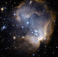 Near the outskirts of the Small Magellanic Cloud, a satellite galaxy some 200 thousand light-years distant, lies the young star cluster NGC 602.