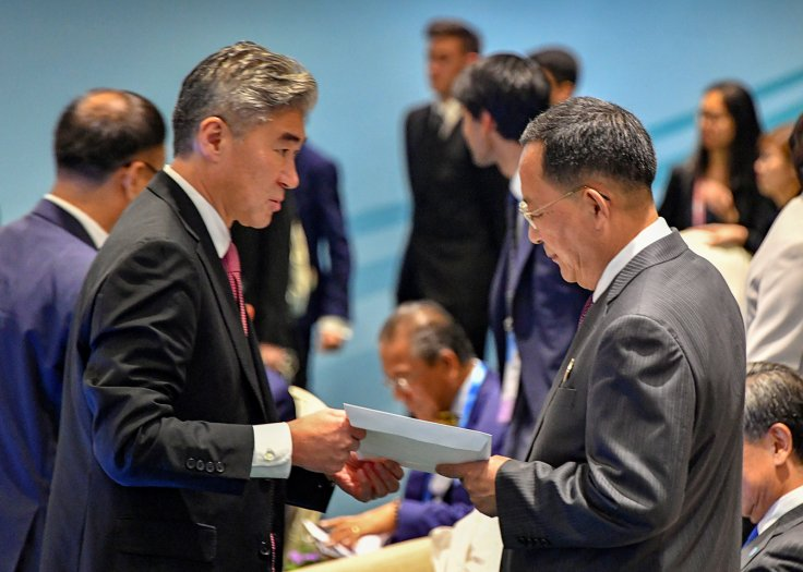 North Korea's Foreign Minister Ri Yong Ho is handed U.S. President Donald Trump's reply to North Korean leader Kim Jong Un's letter, by a member of the U.S. delegation at the ASEAN meeting in Singapore August 4, 2018.