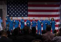 The first U.S. astronauts who will fly on American-made commercial spacecraft, to and from the International Space Station, wave after being announced, Friday, Aug. 3, 2018 at NASA's Johnson Space Center in Houston, Texas. The astronauts are, from left to