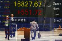 Asian stocks step back from one-year high after Fed rate talks