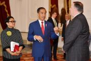 (L-R) Indonesia's Foreign Minister Retno Marsudi stands beside Indonesia's President Joko Widodo as he talks to U.S. Secretary of State Mike Pompeo before their meeting at the Presidential Palace in Jakarta, Indonesia, August 5, 2018.