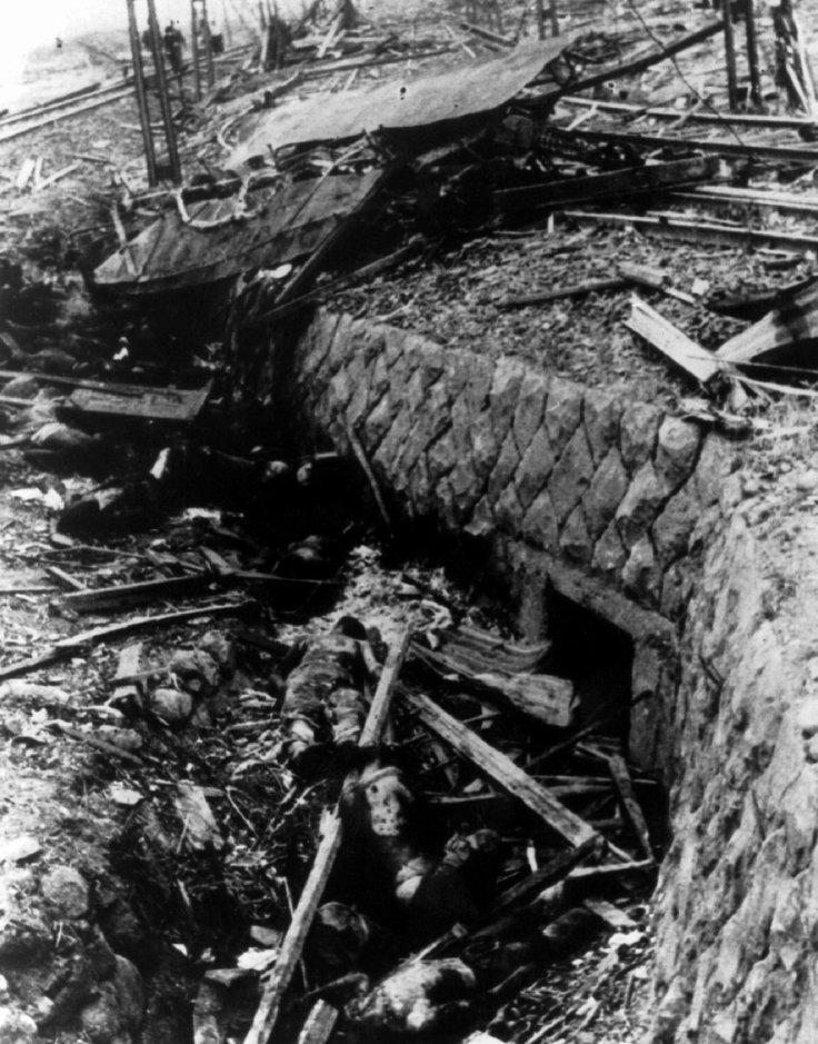 This August 1945 file photo from captured Japanese film shows victims of the atomic bomb who were thrown clear of a tramcar they were riding into a ditch near the the tracks, when the bomb was dropped on Nagasaki on August 9, 1945. The bomb, nicknamed