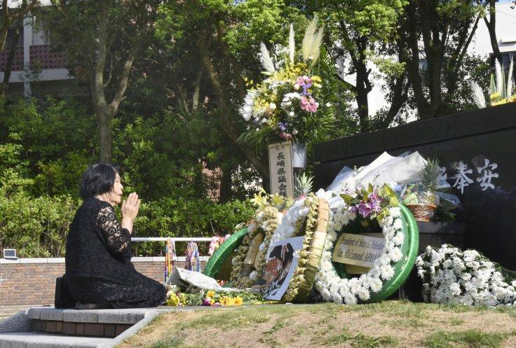 A woman prays for victims of the 1945 atomic bombing on a day commemorating the 73rd anniversary of the bombing at Nagasaki's Peace Park, western Japan, in this photo taken by Kyodo August 9, 2018.