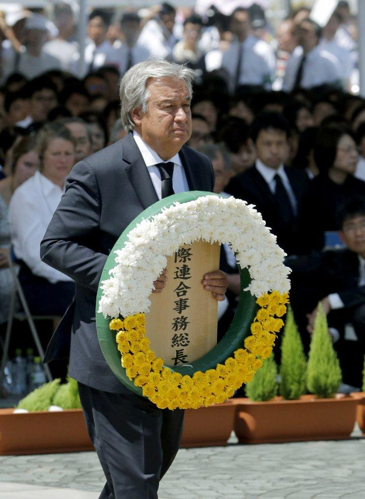 U.N. Secretary General Antonio Guterres offers a flower wreath for the victims of the 1945 atomic bombing during a ceremony commemorating the 73rd anniversary of the bombing at Nagasaki's Peace Park, western Japan, in this photo taken by Kyodo August 9, 2