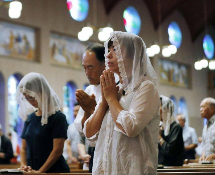 Local residents pray for victims of the 1945 atomic bombing during a mass at the Urakami Cathedral in Nagasaki, western Japan, August 9, 2018, on the 73rd anniversary of the bombing of Nagasaki.