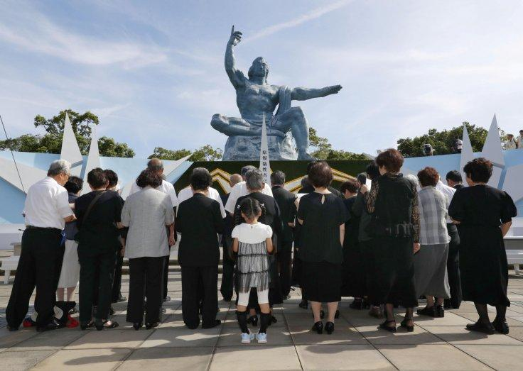People pray for victims of the 1945 atomic bombing in front of the Peace Statue on a day commemorating the 73rd anniversary of the bombing at Nagasaki's Peace Park, western Japan in this photo taken by Kyodo August 9, 2018.