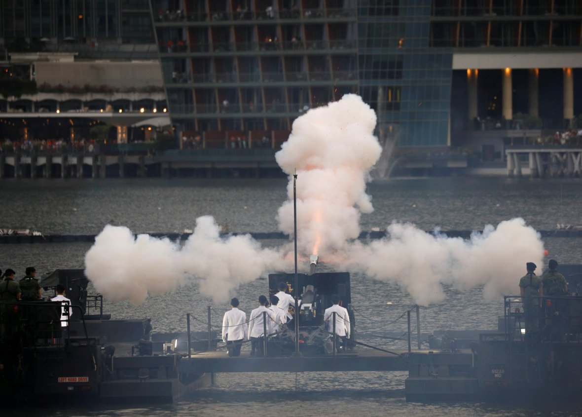 Howitzer is fired during a 21-gun salute at the National Day parade along Marina Bay in Singapore August 9, 2018.