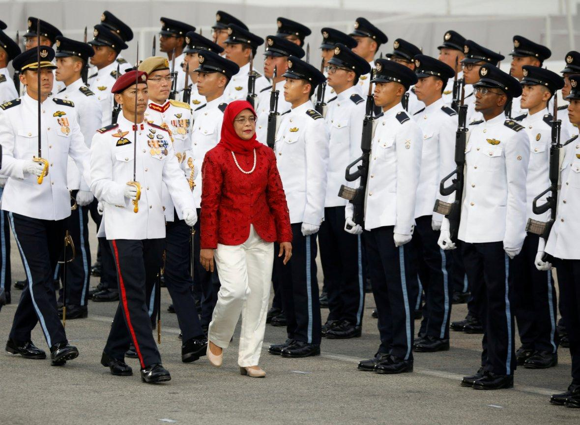 Singapore's President Halimah Yacob inspects the guard of honour at the National Day parade along Marina Bay in Singapore August 9, 2018.