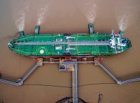 An oil tanker unloads crude oil at a crude oil terminal in Zhoushan, Zhejiang province, China July 4, 2018.