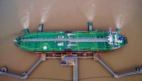 An oil tanker unloads crude oil at a crude oil terminal in Zhoushan, Zhejiang province, China July 4, 2018.