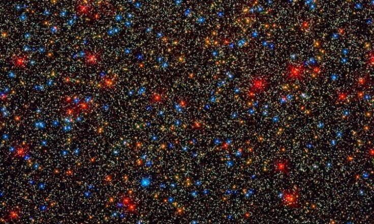 There are colorful stars galore, but likely no habitable planets, inside the globular star cluster
