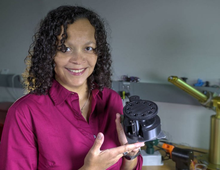 NASA scientist Melissa Floyd holds her 3D-printed FISHbot prototype, which she is advancing to search for bacterial life on Mars and other solar system targets.