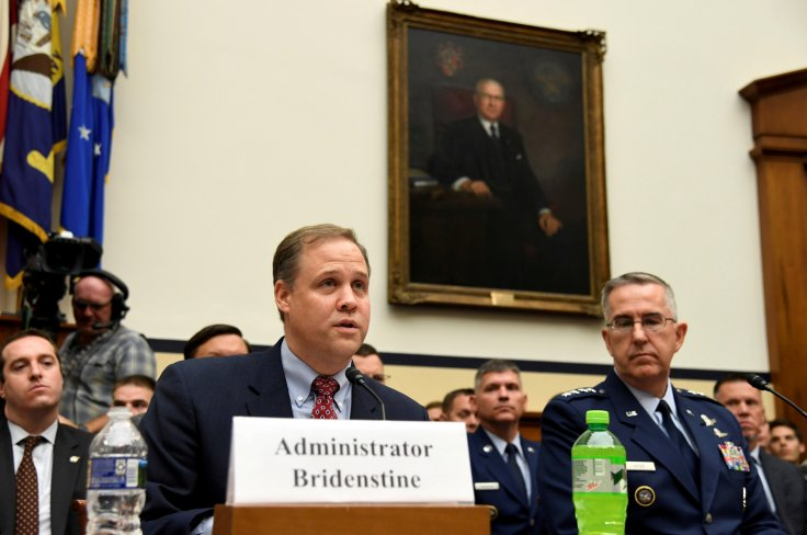 NASA Administrator Jim Bridenstine (L) makes remarks as US Strategic Command Commander Gen. John Hyten listens during the House Armed Services Strategic Forces Subcommittee's joint hearing with the House Science, Space and Technology Committee, in Washing