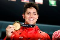 018 Asian Games - Men's 100m Butterfly Final - GBK Aquatics Center - Jakarta, Indonesia - August 22, 2018 Gold medalist Joseph Isaac Schooling of Singapore poses for a photo during the medal ceremony