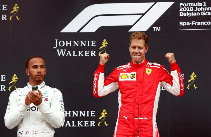 Spa-Francorchamps, Stavelot, Belgium - August 26, 2018 Ferrari's Sebastian Vettel celebrates on the podium after winning the race while Mercedes' Lewis Hamilton looks on