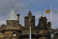 """A Lion Rampant flag, the Royal Standard of Scotland, flies at half mast after the death of former British prime minister Margaret Thatcher, over the Palace of Holyroodhouse in Edinburgh, Scotland April 8, 2013. Thatcher, the """"Iron Lady"""" who dominated Brit"""