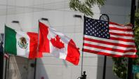Flags of the U.S., Canada and Mexico fly next to each other in Detroit, Michigan, U.S. August 29, 2018. REUTERS/Rebecca Cook/File Photo