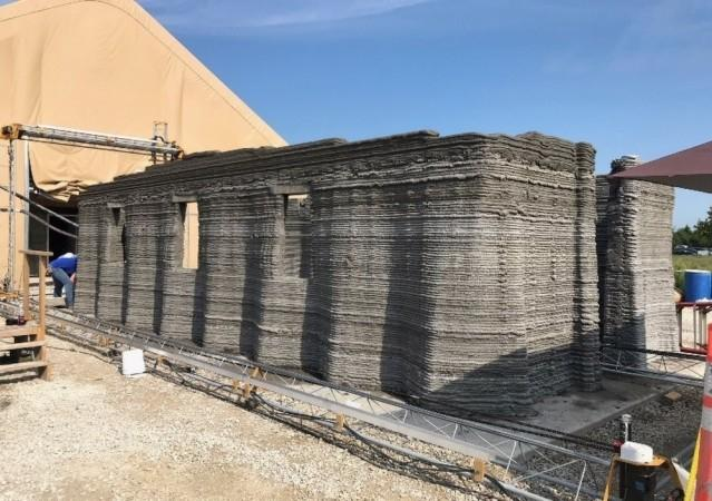 The world's largest concrete 3D printer constructs a 500-square-foot barracks hut at the U.S. Army Engineer Research and Development Center in mid-August in Champaign, Illinois.