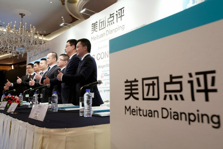 Management team of China's Meituan Dianping, an online food delivery-to-ticketing services platform, attend a news conference on its IPO in Hong Kong, China September 6, 2018.